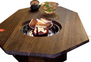 Regular Octagonal IRORI dining table made of Paulownia wood fired on surface